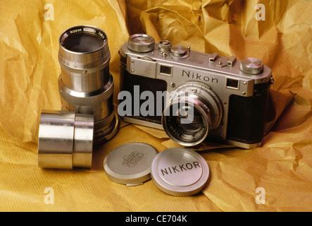 AAD 83949 : old antique 35 mm Nikon rangefinder camera Nikkor wide angle telephoto lens cap - Stock Photo
