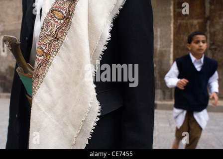Man in traditional clothes in the old city of Sana'a, a UNESCO World Heritage Site, Yemen, Western Asia, Arabian - Stock Photo