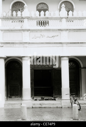 Travel Documentary - Shoes at the entrance to the Al Abra Mosque in Chinatown Singapore in Southeast Asia Far East. - Stock Photo