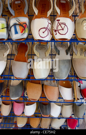 Outside stall of shoes and sandals in Cuitadella, Menorca, Spain, Balearic Islands, October, 2011. - Stock Photo