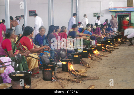 indian women cooking sweet jaggery rice to celebrate onam festival kerala india - Stock Photo
