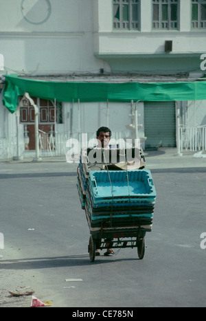 A laborer on the way to market in central Tripoli. - Stock Photo