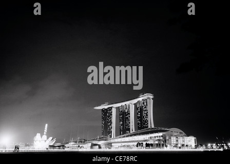 Marina Bay Sands and the ArtScience Museum in Singapore in Far East Southeast Asia. Sky Sunset Dusk Skypark Modern - Stock Photo