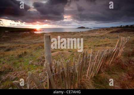 Sunset over Bantham dunes and Bigbury Bay in South Devon - Stock Photo