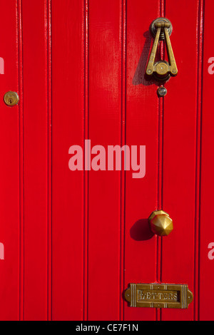 Red door with mail slot, near Galway, Ireland - Stock Photo