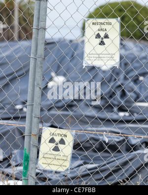 Restricted area sign on fence - Stock Photo