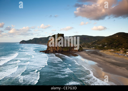 Piha beach and Lion Rock at dusk. Piha, Waitakere Ranges Regional Park, Auckland, North Island, New Zealand - Stock Photo