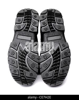 Anti-skid soles on men's winter boots. Isolated on white with natural shadows. - Stock Photo