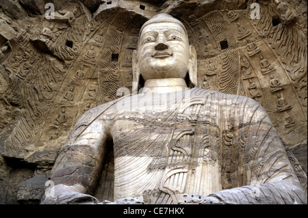 The 13.7-meter-tall colossal Buddha excavated from the sandstone cliff at cave number 20 in the ancient rock cut - Stock Photo