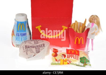 McDoanld's Happy Meal with a hamburger, french fries, milk and apple dippers and a Barbie doll toy on white background, - Stock Photo