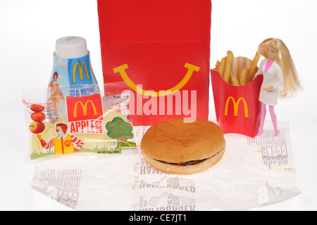 McDoanld's Girls Happy Meal with a hamburger, french fries, milk and apple dippers, a Barbie doll toy & box on white - Stock Photo