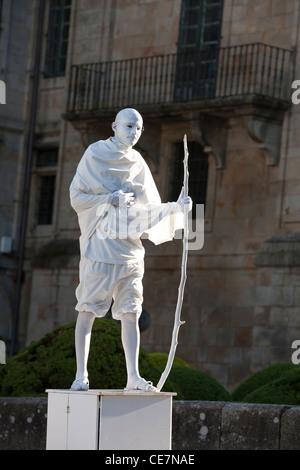 Street performer dressed as Gandhi - Santiago de Compostela - Santiago de Compostela, Galicia, Spain - Stock Photo