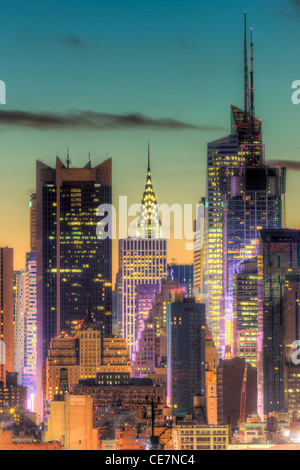 The Chrysler Building, Bank of America Tower, and other buildings near 42nd Street during morning twilight as viewed - Stock Photo