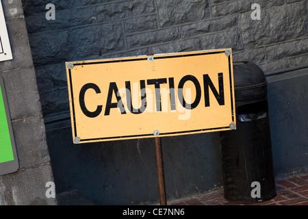Yellow Caution sign close up - Stock Photo