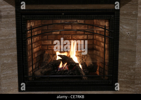 burning fireplace warm luxury modern - Stock Photo
