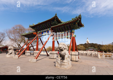 Entrance gate at Beihai Park Beijing China, with the White Pagoda in the background. - Stock Photo