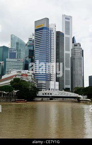 Fullerton Hotel and Anderson suspension bridge, Singapore. - Stock Photo