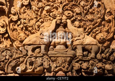 The Hindu goddess Lakshmi, flanked by elephants, Banteay Srei temple, Citadel of the Women, Angkor, Cambodia - Stock Photo