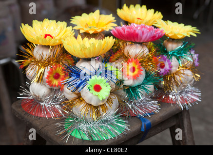Mini Garlic Christmas Trees on sale in Chinatown Ho Chi Minh Vietnam - Stock Photo