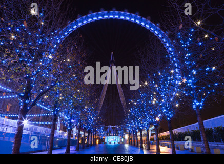 The London Eye (Millennium Wheel) at night, River Thames, London, England - Stock Photo