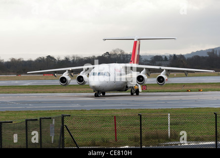 Swiss International Air Lines Bae Avro 146-RJ100 Airliner HB-IYZ Taxiing at Manchester International Airport England - Stock Photo
