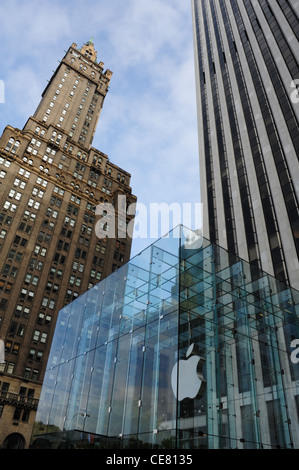 Blue sky portrait Sherry Netherland Hotel General Motors Building rising above glass cube Apple Store, 5th Avenue, - Stock Photo