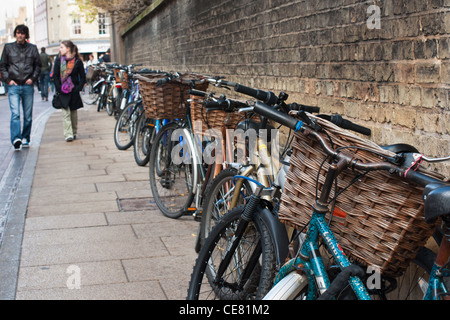 A line of bicycles parked outside a Sydney Sussex college. Cambridge. England. - Stock Photo