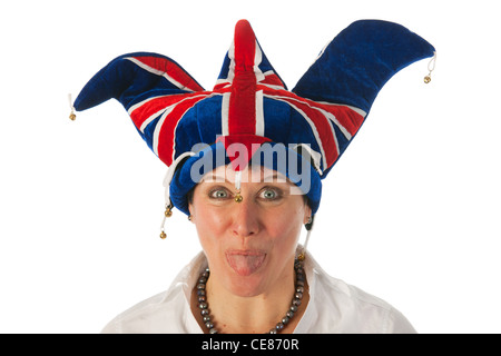 Funny Britisch girl is sticking her tonque out - Stock Photo