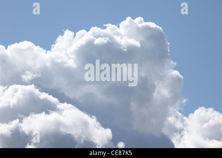cumulonimbus clouds in late summer getting ready for a heavy shower - Stock Photo