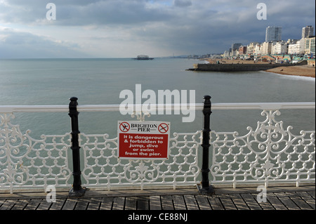 Warning sign on Brighton Palace Pier. - Stock Photo