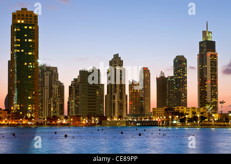 Dubai, Skyscrapers at Night - Stock Photo