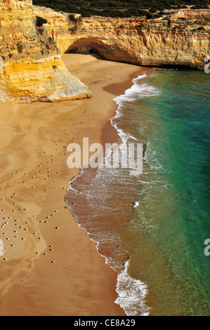 Portugal, Algarve: Untouchable and unspoiled rocky bay at the coast around Carvoeiro - Stock Photo