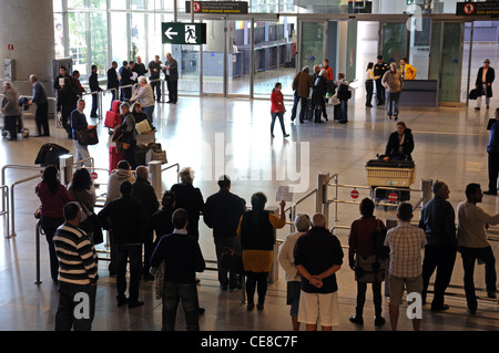 People waiting for passengers in the arrivals hall, Terminal 3, Malaga airport, Malaga, Malaga Province, Spain, - Stock Photo