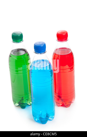 three colored plastic bottle with juice - Stock Photo