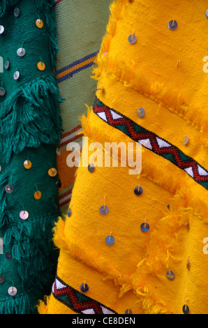Green and yellow rugs or wall-hangings for sale in Morocco - Stock Photo