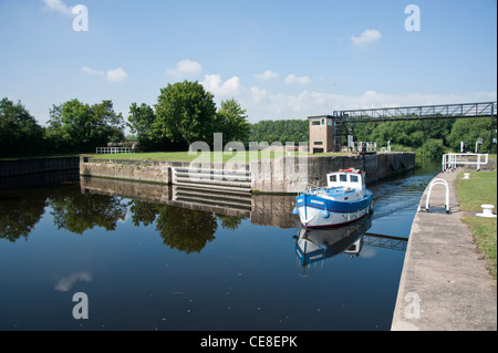 Leisure boat passing through Castleford lock from the Aire and Calder canal to the Leeds and Liverpool canal - Stock Photo