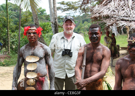 British Traveller visiting a remote village on the Karawari River in  Papua New Guinea - Stock Photo