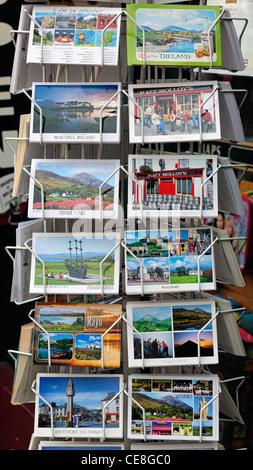 postcards postcard sale display outside shop rack revolving stand westport mayo ireland tourist tourism - Stock Photo