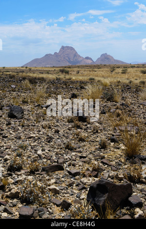 The peaks of Spitzkoppe standing out from the horizon, seen from the vast plain of the Namib Desert. Damaraland, - Stock Photo