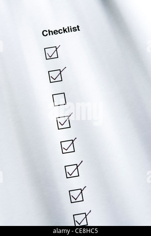 Checklist, one box not ticked - Stock Photo