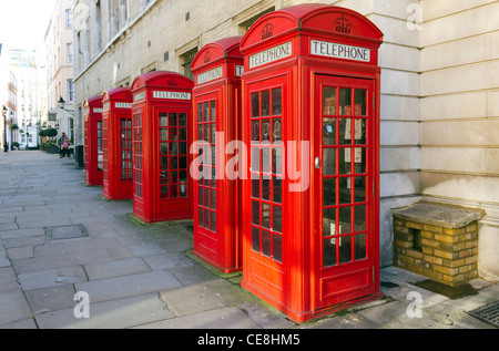 red telephone boxes, Covent Garden, London, England, UK - Stock Photo