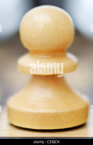 One Chess Pawn on white background with faint reflextion. - Stock Photo
