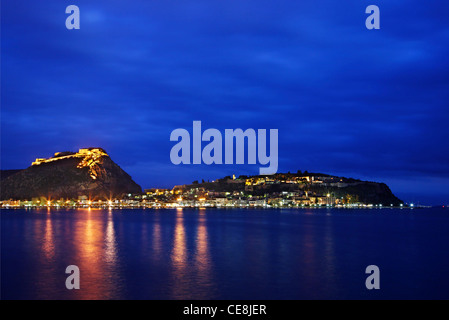Panoramic night view of Nafplio town with the castles of Palamidi and Akronafplia right above it. Argolis, Peloponnese, - Stock Photo