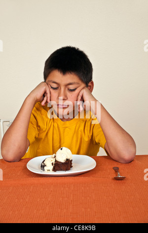 Strong willed stubborn 10-11 year old Hispanic boy Sitting