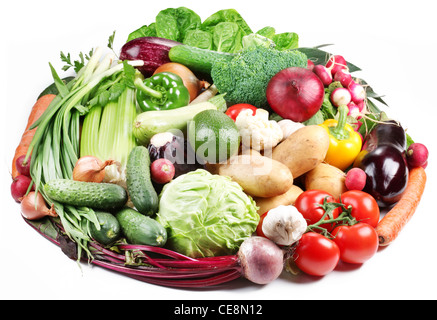 Variety of vegetables are laid out in a circle on a white background. - Stock Photo