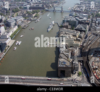 Aerial image of the Thames at London Bridge, looking east towards HMS Belfast and Tower Bridge, Southwark, London - Stock Photo