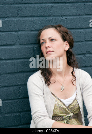MODEL RELEASED. Woman deep in thought. - Stock Photo