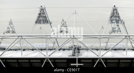 Floodlights on the rooftop lighting towers at 2012 London Olympic stadium being tested on a grey overcast day Stratford - Stock Photo
