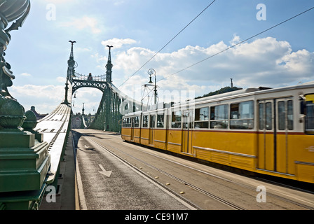 Tram on Liberty Bridge or Freedom Bridge (Szabadsag hid), Budapest, Hungary. - Stock Photo