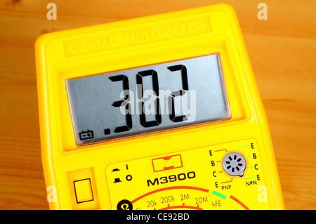 Yellow digital multimeter, England, UK, Western Europe. - Stock Photo